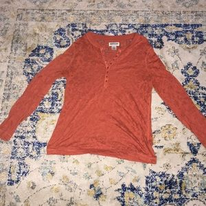 A beautiful amber colored long sleeve shirt